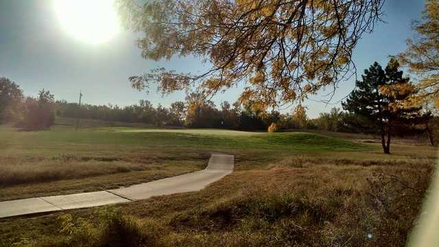 A sunny view of a hole at Indian Hill Golf Course