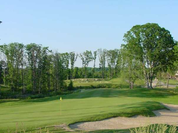 A view of the 14 th green with bunker on the right at Coyote Preserve Golf Club