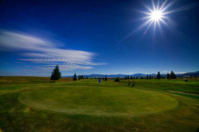 A sunny day view of a hole at Fairmont Hot Springs Resort