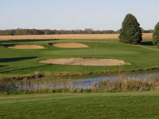 A view of green at Shambolee Golf Club with bunkers in background