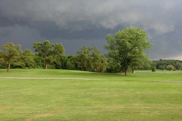 A cloudy day view of a hole at Oak Knoll Golf Club