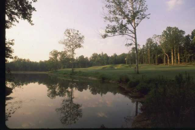 View of a green over water at Springfield Golf Club