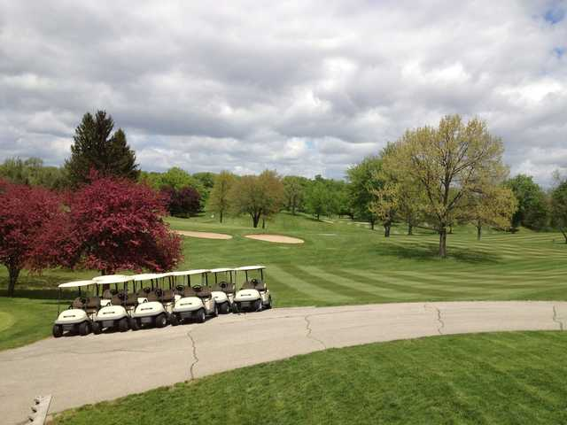 A view of a green protected by bunkers at Hills of Lenawee Golf Club & Banquet Center.
