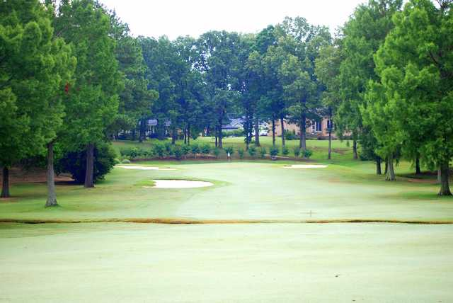 A view of a green surrounded by bunkers at Back Acres Country Club