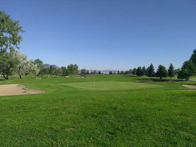 A view of a green protected by bunkers at Bill Roberts Golf Course