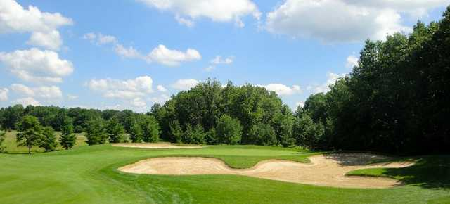 A view of green #17 surrounded by bunkers at Whittaker Woods Golf Course