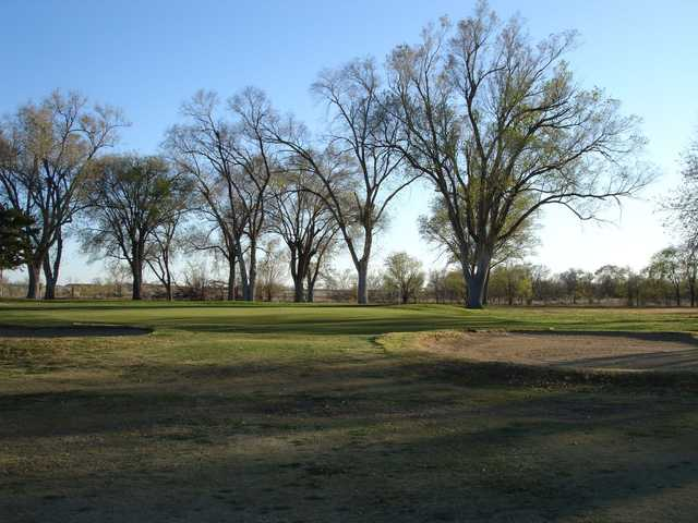 A view of a green protected by sand traps at Hobbs Country Club