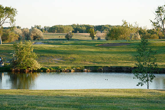 A view over the water of the 11th hole at Eagle Ridge Golf Club