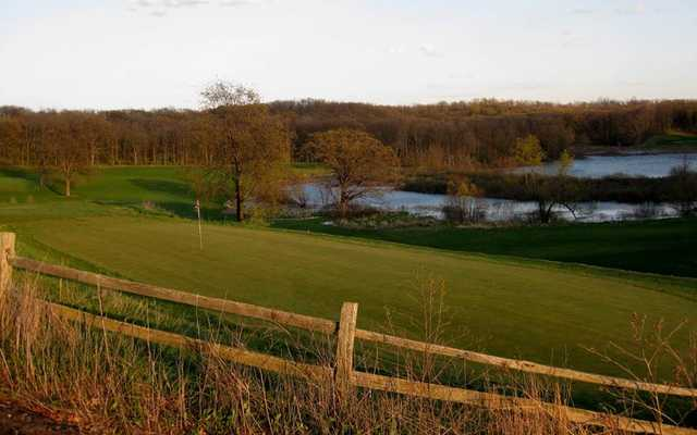 A view over a fence at Irish Hills Golf Course & Valley Resort