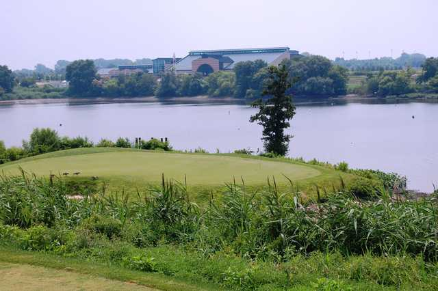 A view of green surrounded by water at RiverWinds Golf Club