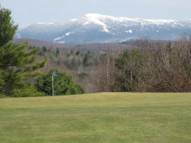 A view of hole #17 and Mt. Mansfield in the distance at Essex Country Club