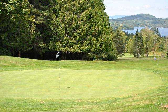 A view of green #8 and the Caspian Lake lake in the distance at Mountain View Country Club