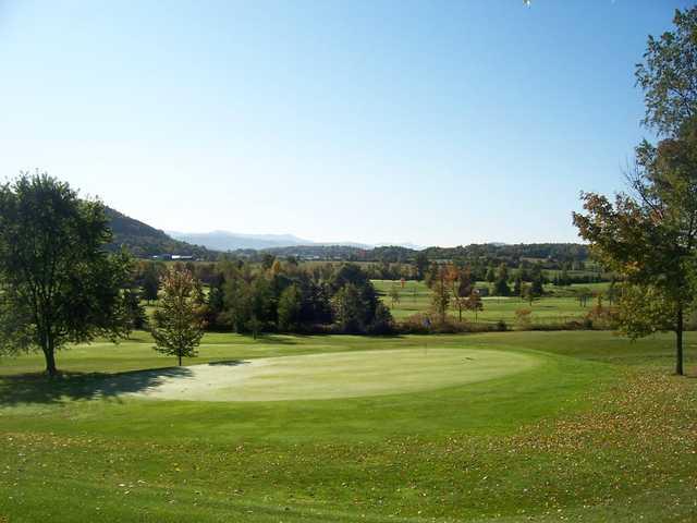 A fall view of a green at Rocky Ridge Golf Club