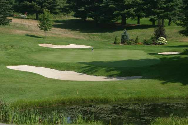 A view of a green protected by bunkers at Williston Golf Club