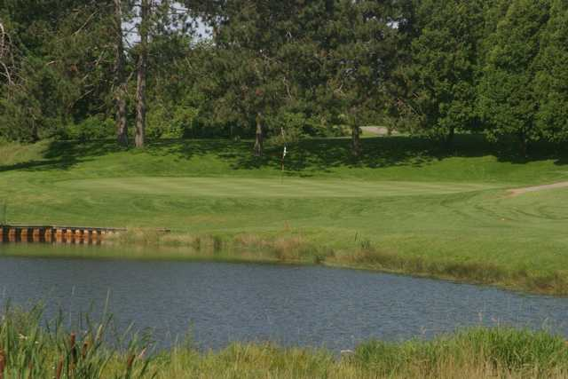 A view over the water of a hole at Williston Golf Club