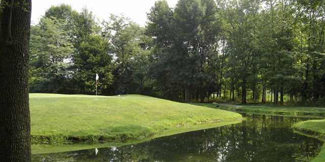 A green view surrounded by water at Gray Eagle Golf Club
