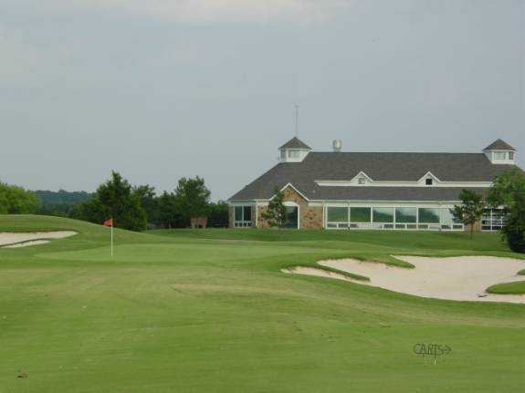 A view of green #18 and clubhouse in background at Tangle Ridge Golf Club