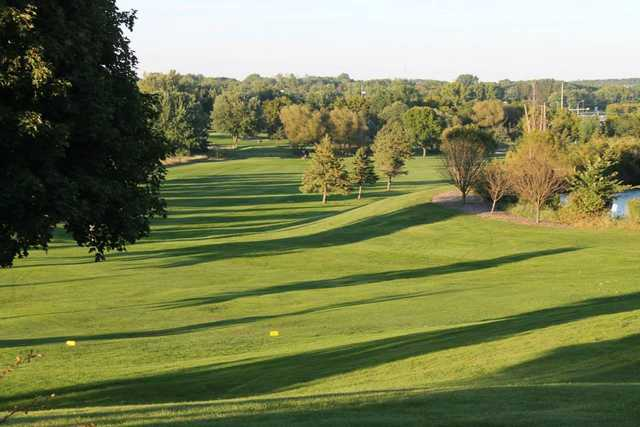 A sunny day view of a fairway at Northern Hills Golf Club