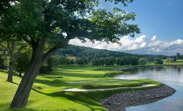 A view of a green with water coming into play at Leatherstocking Golf Course