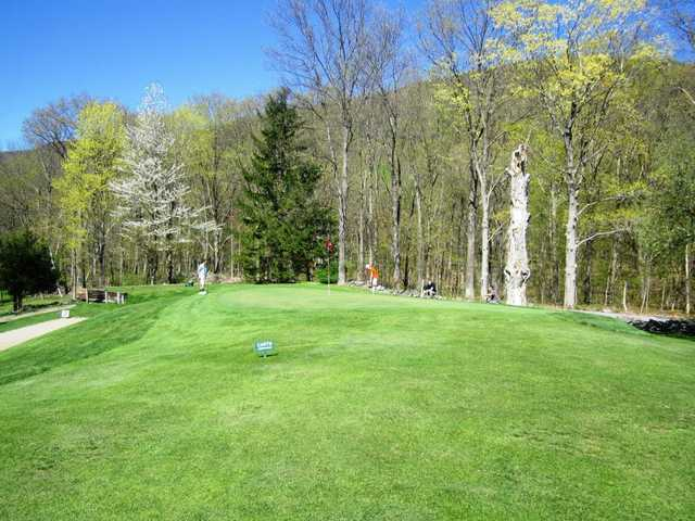 A splendid spring day view of a green at Undermountain Golf Course