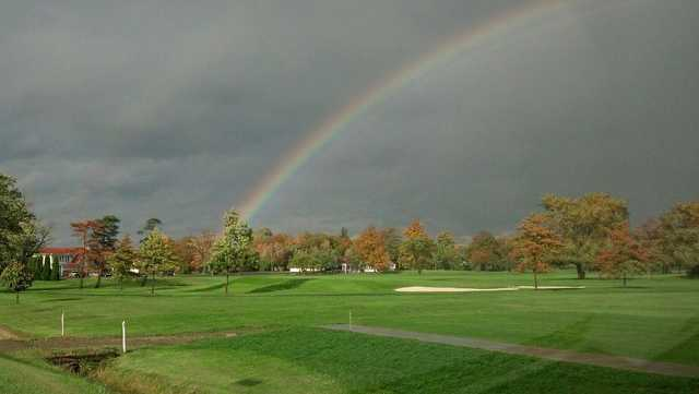 A splendid fall day view with a rainbow over Shorewood Country Club