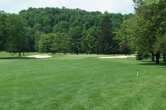 A view of the 18th green guarded by bunkers at Wayne Hills Country Club