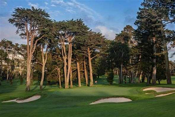 A view of the 9th green protected by bunkers from Lake at Olympic Club