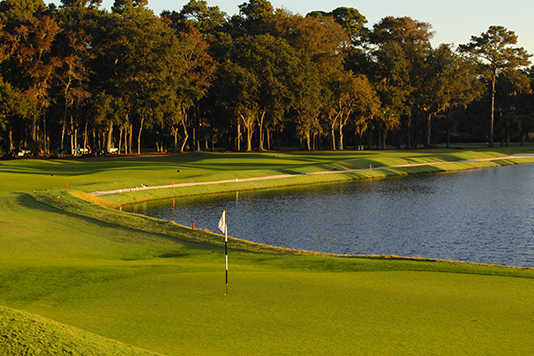 A fall day view of a green from Heron Point at Sea Pines Resort