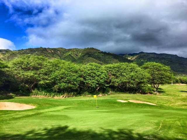 A view of a green protected by bunkers at Kahili Golf Course