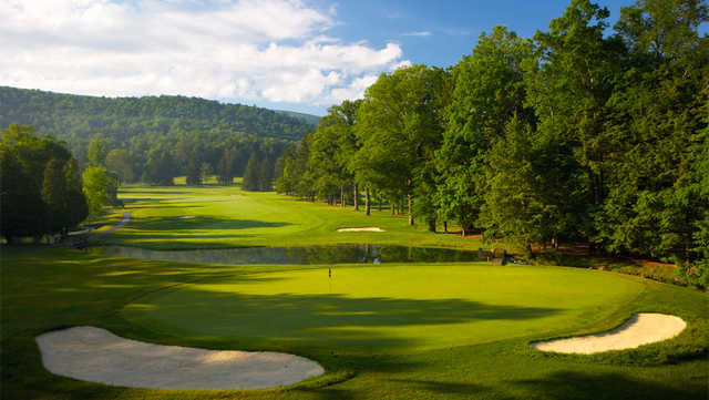 A view of a green with water and bunkers coming into play at Cascades Golf Course from The Homestead Resort