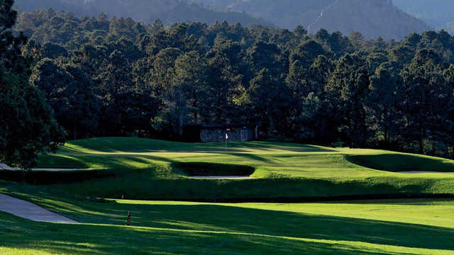 A view of a hole protected by bunkers at Broadmoor Golf Club