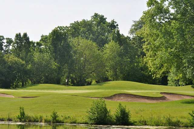 View of a green and bunker at Chalet Hills Golf Club