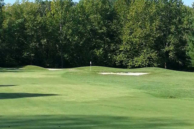 A view of hole #17 guarded by bunkers at Fox Creek Golf Club.