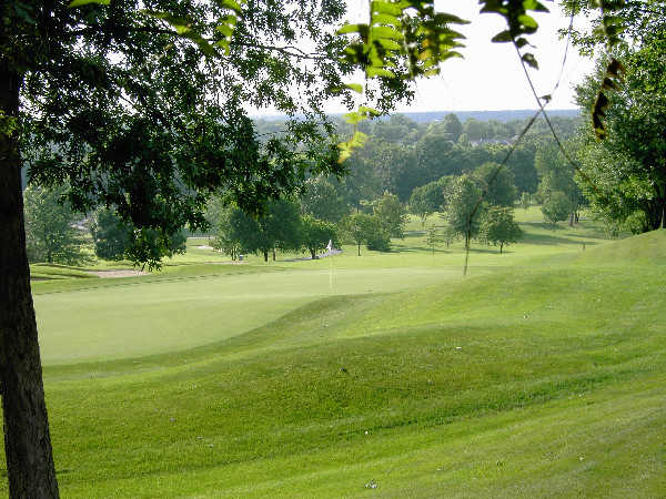 A summer day view of a hole at Lake Forest Country Club