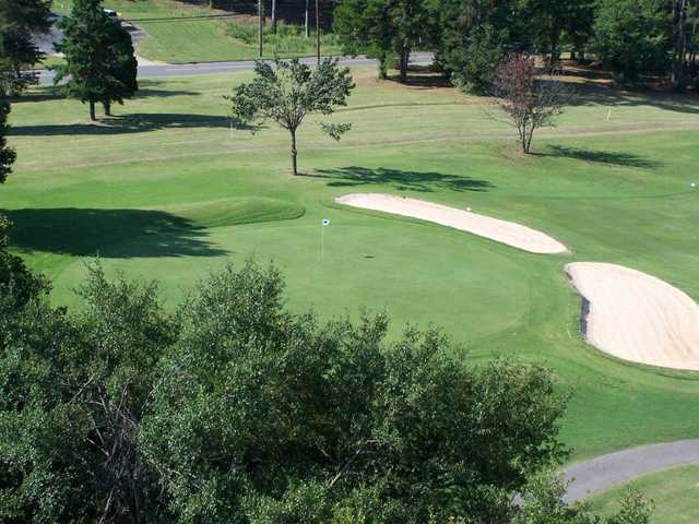 A view of a green protected by bunkers at Royster Memorial Golf Course