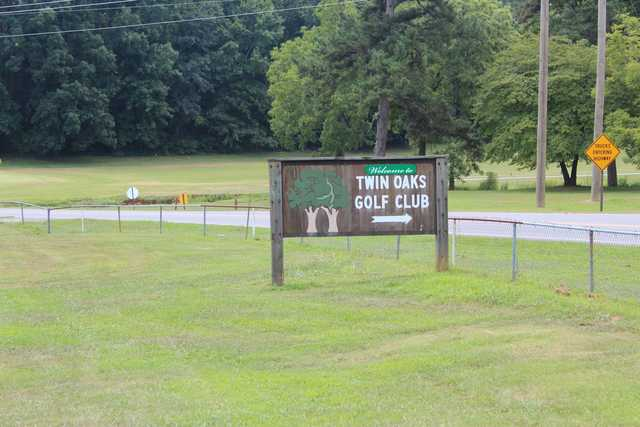 A view of the Twin Oaks Golf Club sign