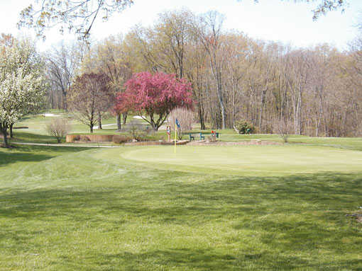 A spring day view of a green at Yankee Run Golf Course