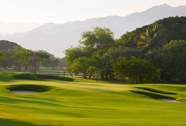 A sunny day view of a hole at The Greg Norman Signature Course from Vidanta Nuevo Vallarta