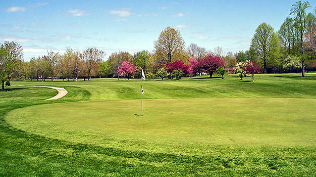 A spring day view of a green at Erie Shores Golf Course