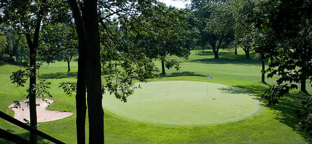 A sunny day view of a green at Moundbuilders Country Club