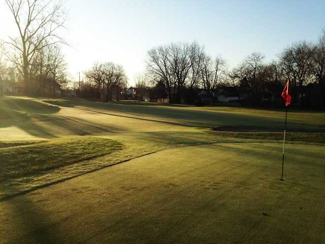 A sunny day view of a green at Washington Golf Learning Center