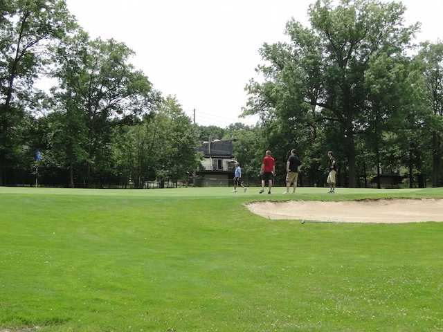A sunny day view of a hole at Ridgewood Golf Course
