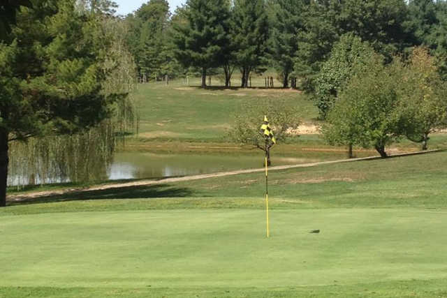 A view of a hole with water in background at Meigs County Golf Course