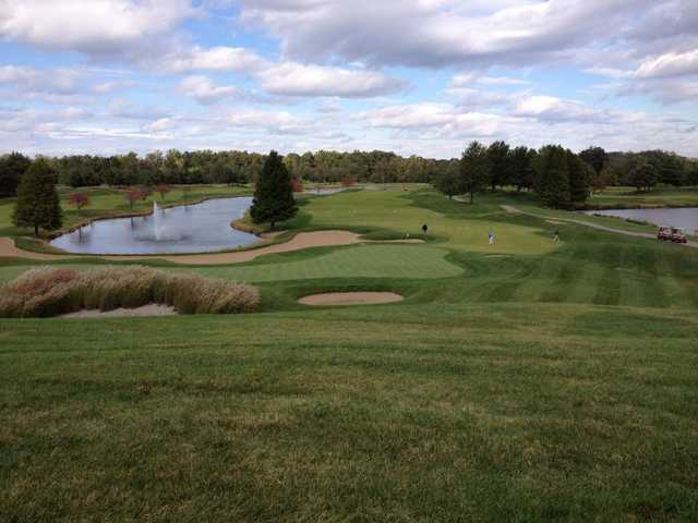 A view of a green protected by sand traps at Riverside Greens