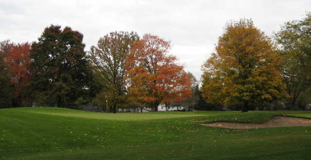 A fall day view of a green at Highland Meadows Golf Club