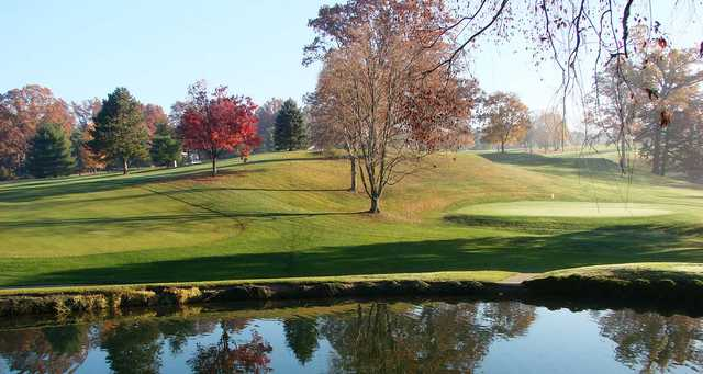 A view of a green with water coming into play at Wooster Country Club