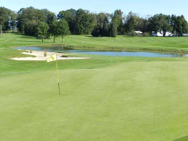 A view of a green with water coming into play at Southmoore Golf Course