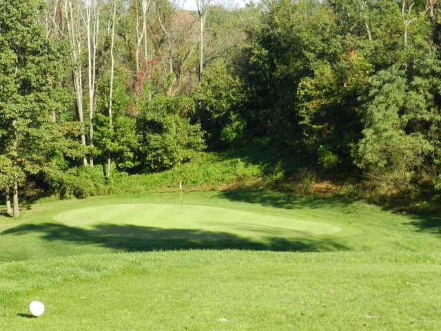 A sunny day view of a hole at Southmoore Golf Course
