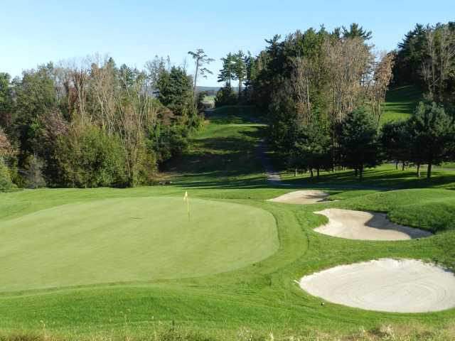 A view of a green protected by bunkers at Southmoore Golf Course