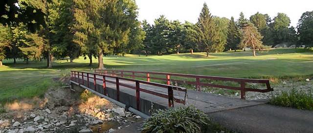 View of a bridge and green at Ashland Golf Club